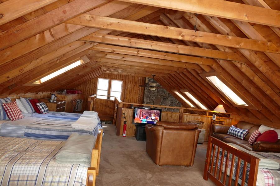 Loft bedding with TV