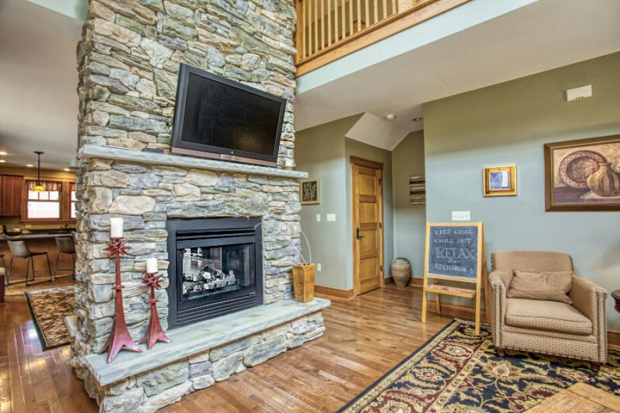 Living Room seating towards TV. Fireplace