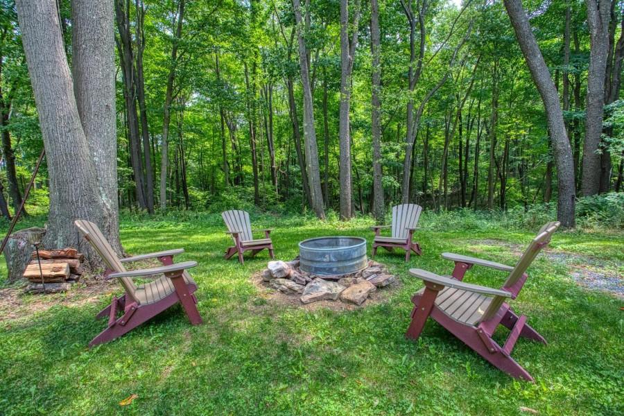 seating around firepit backyard